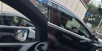網傳男司機抱小孩駕駛照片。 網圖