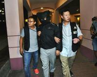 張健華被捕。