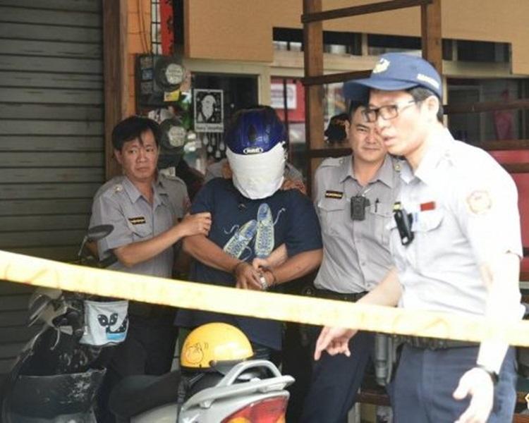 警方將疑犯拘捕。圖:自由時報