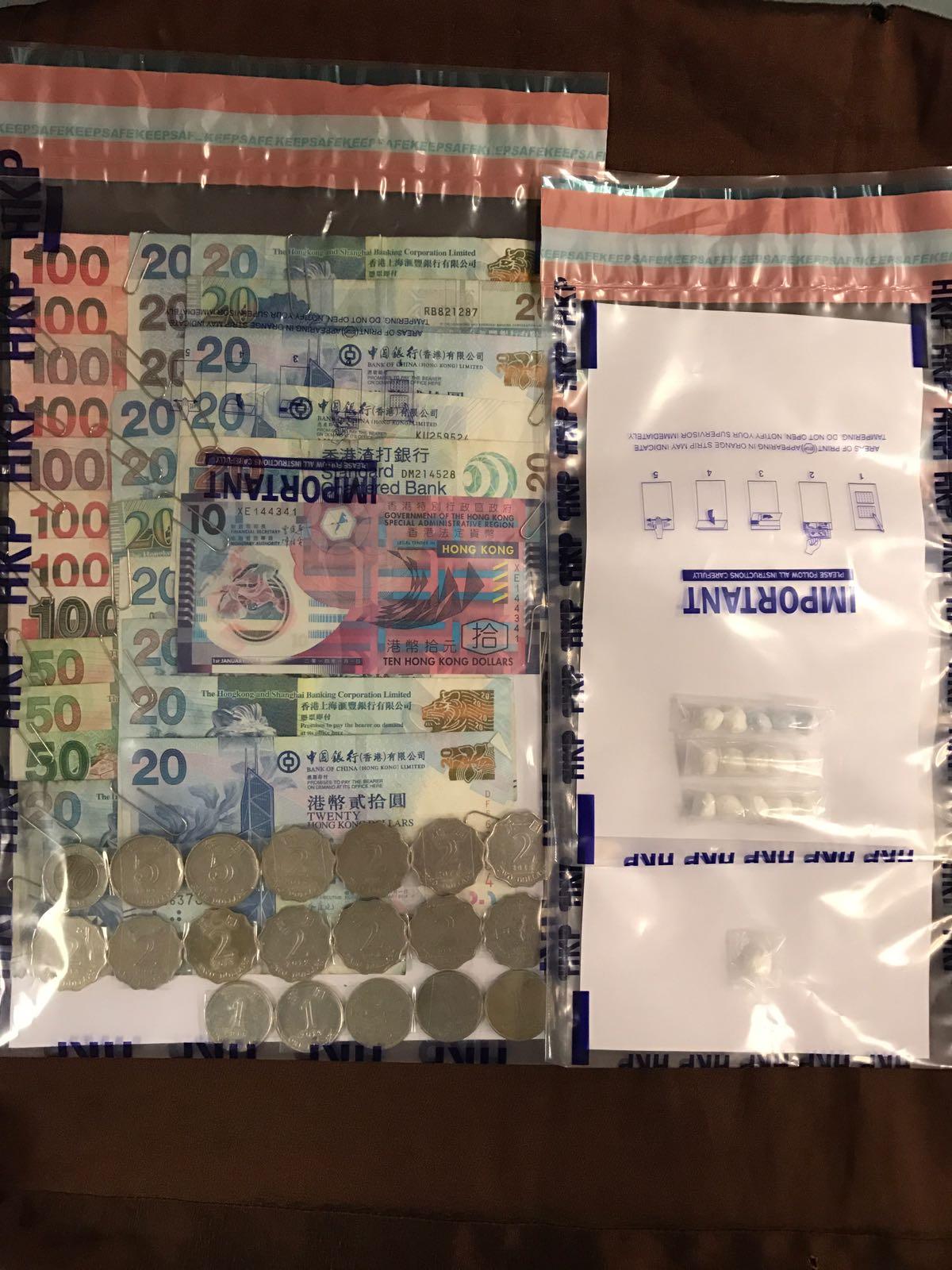 行動中檢獲的懷疑毒品及現金。