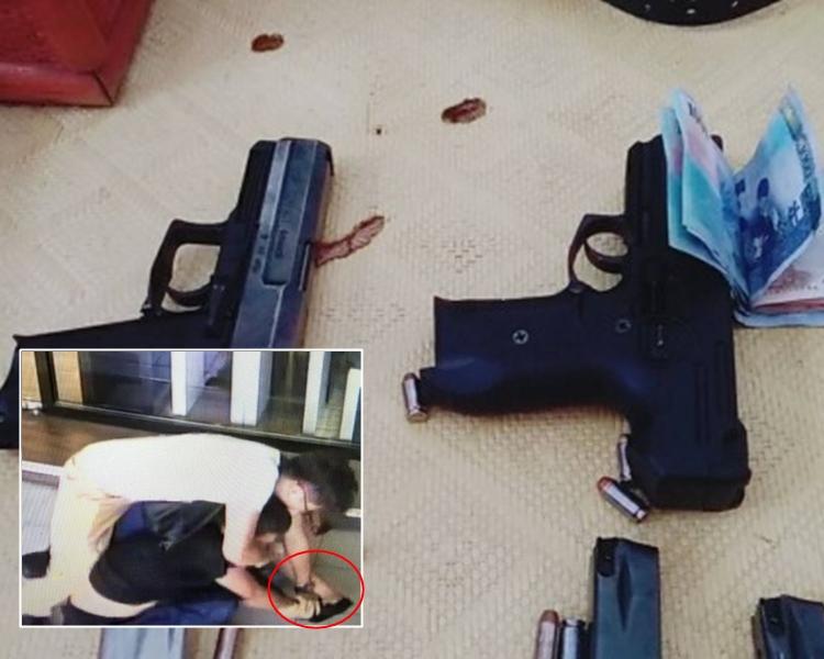 柯男被警員制服時,手還持着槍。