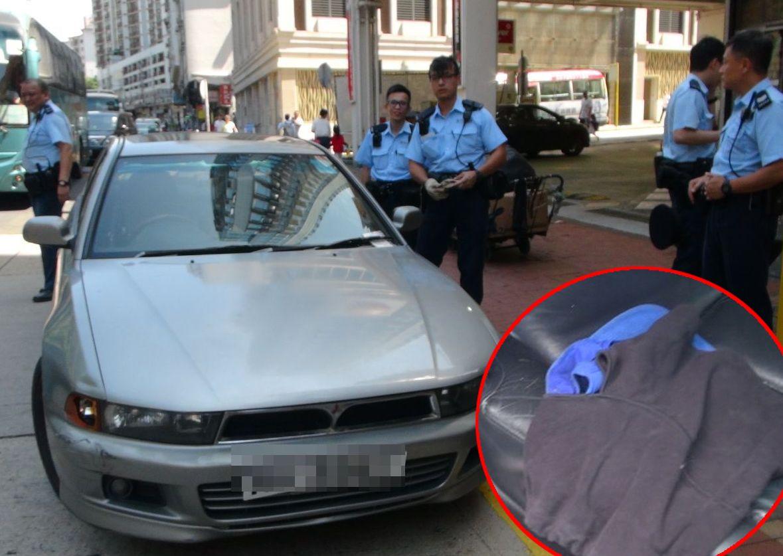 警方在車內發現頭套。林思明攝
