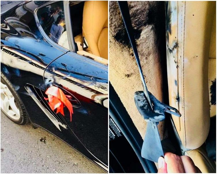 黑色的保時捷跑車有被鞭炮炸過的痕跡。fb「台灣新聞記者聯盟資訊平台」專頁