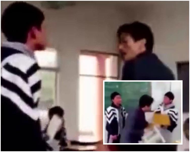 一名學生在課室的走道中,本來已與男教師爭執。