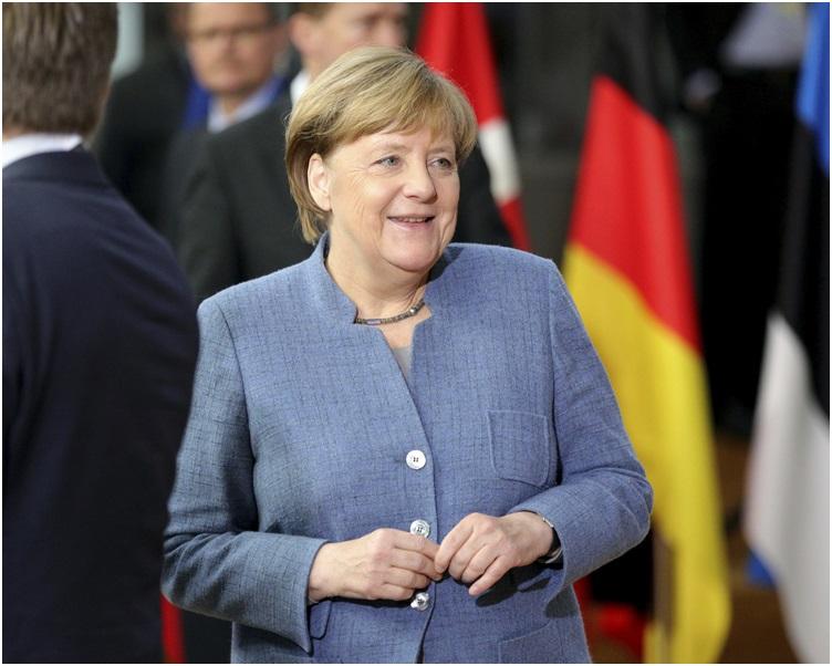 默克爾同意為收容難民人數設定上限,或對談判造成障礙。AP