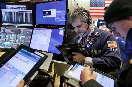美股周二上升。AP