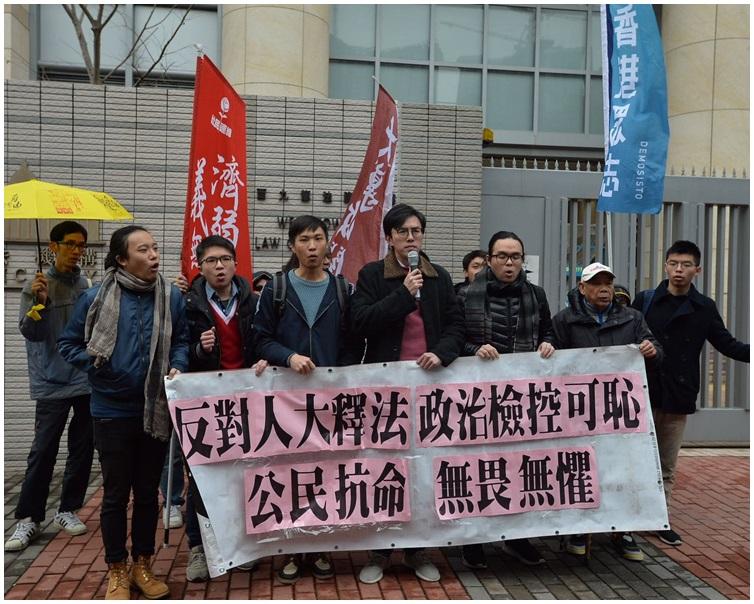 吳文遠等人被控於「反釋法遊行」煽惑他人擾亂公眾秩序等罪。資料圖片