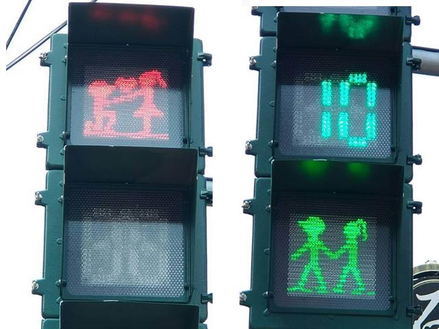 台灣屏東縣警察局近日推出「情侶檔」交通指示燈,將原本紅綠燈中孤家寡人的綠公仔添加女朋友。 網圖