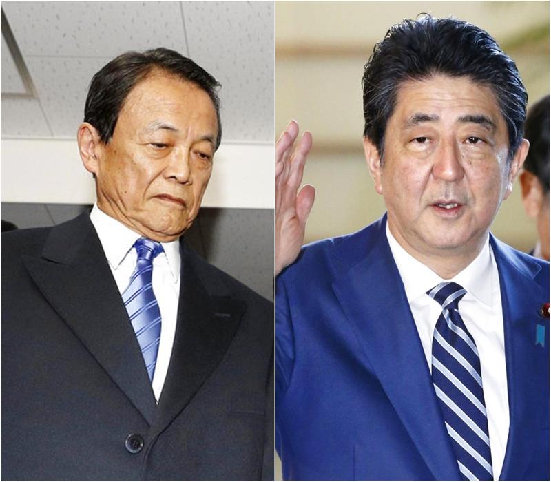 財務大臣麻生太郎(左)涉嫌掩飾首相安倍晉三裙帶主義醜聞。Ap圖片