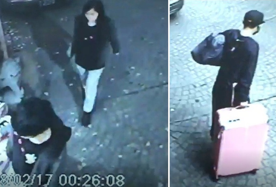 陳拖著一個粉紅色的行李篋進入旅社,潘則跟隨在身後。(左圖)