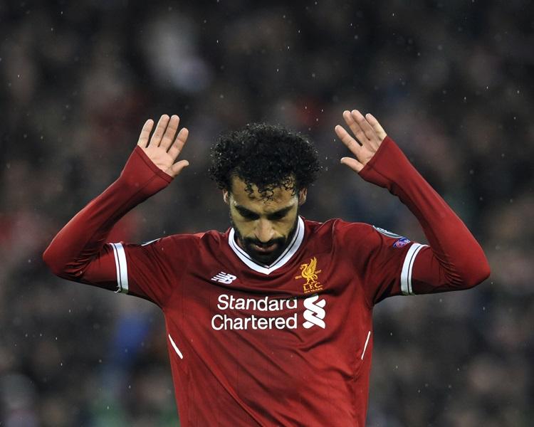 沙拿入球後舉手拒絕慶祝。AP