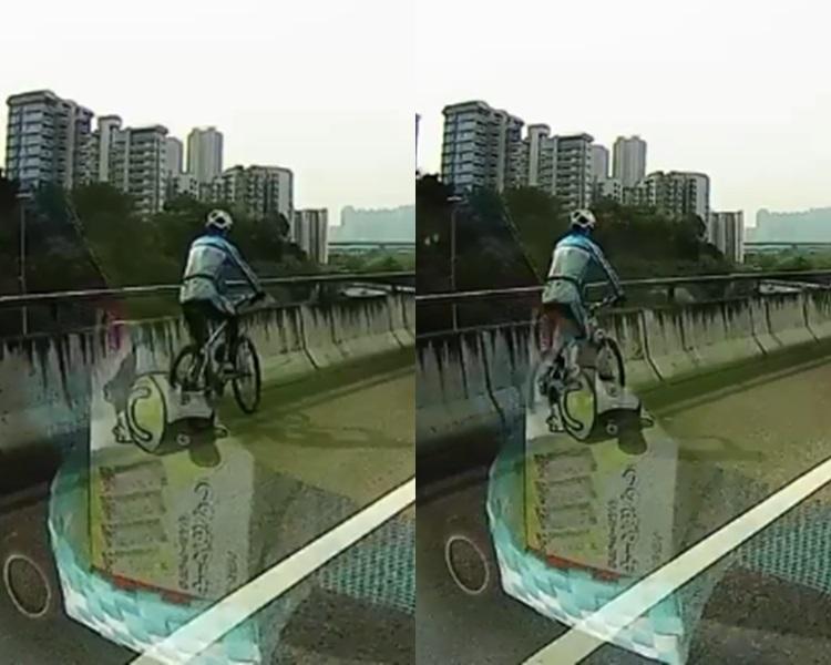 西九龍高速公路驚現單車男,貨車旁邊駛過險象環生。影片截圖