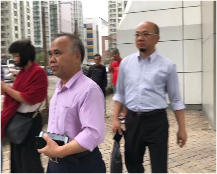 彭惠明(粉紅色裇衫)今早上庭。郭止晅攝