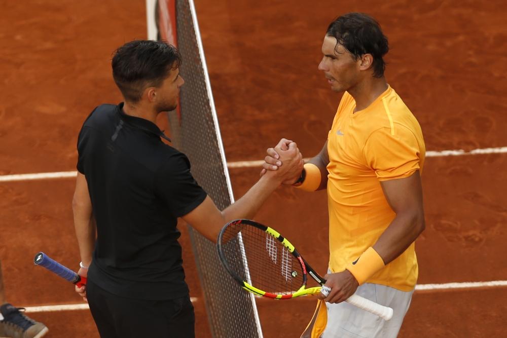 拿度(左)賽後與添姆握手。AP
