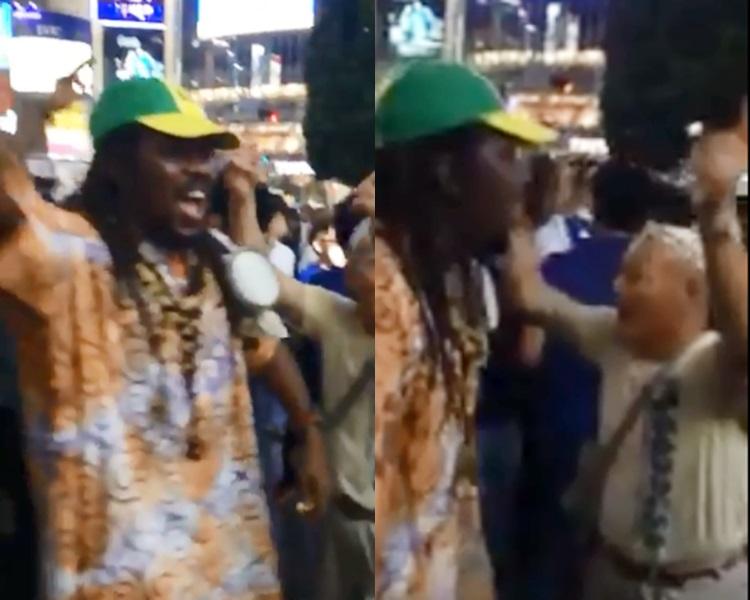 日本和塞内加尔球迷在涩谷街头一同跳舞庆祝。影片截图