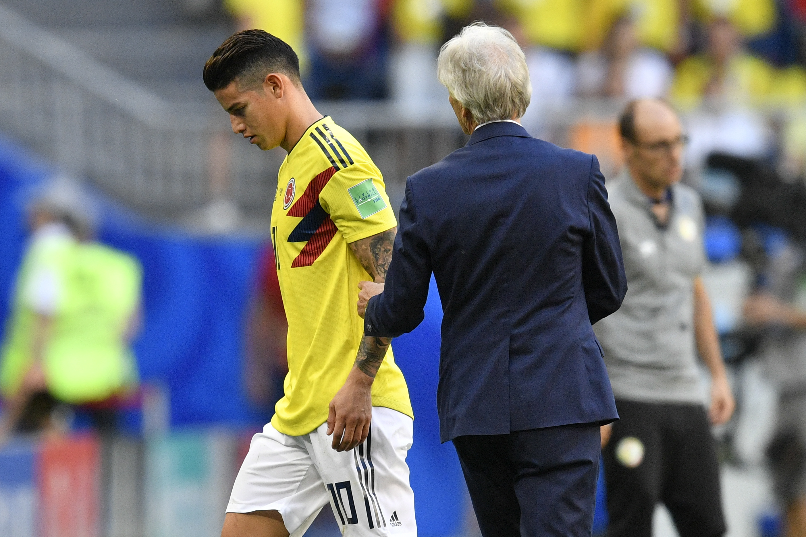 占士洛迪古斯(左)今屆世盃飽受傷患困擾。AP