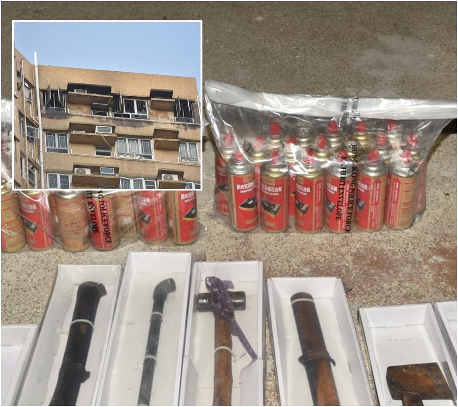 警方在康盛花園單位搜出大批武器及石油氣罐。