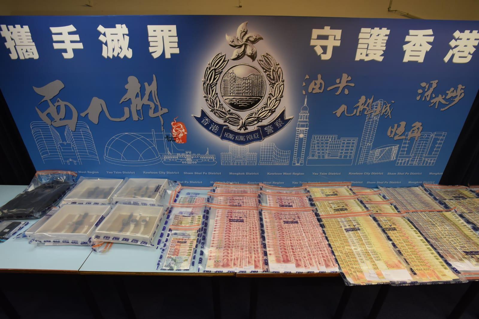 行動中檢獲12隻名表與170多萬港元。尹敬堂攝