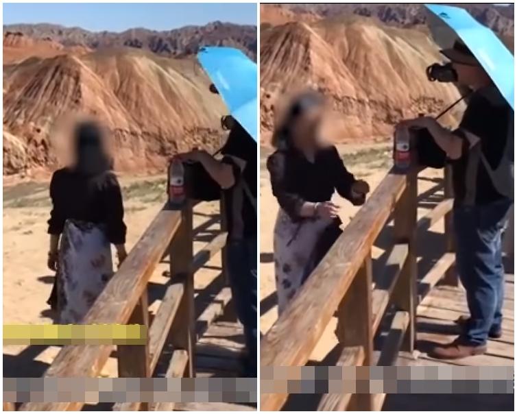 女遊客跨過圍欄,踏在丹霞地貌上拍照。網圖