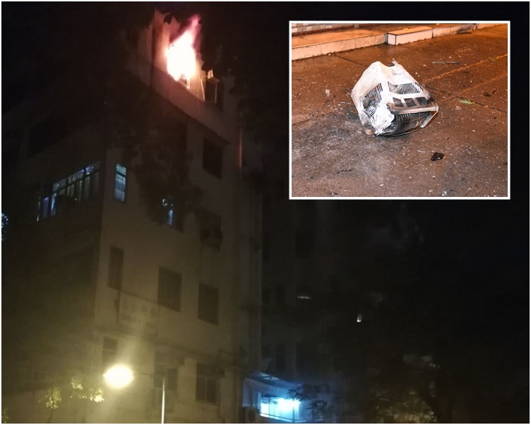 小圖:大火令冷氣機墮街。大圖由讀者提供。