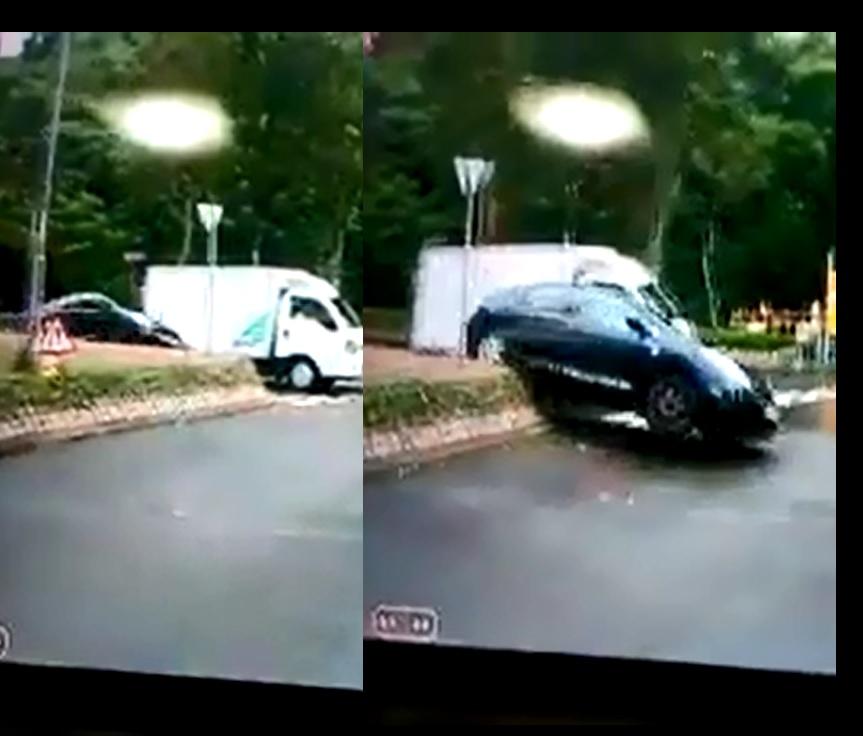 私家車為越過前方停在迴旋處前的貨車,竟高速剷上石壆。影片截圖