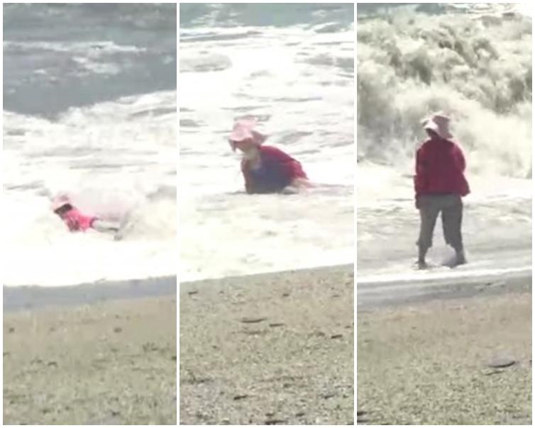 婦人墮海不久後遭大浪吞噬。網圖