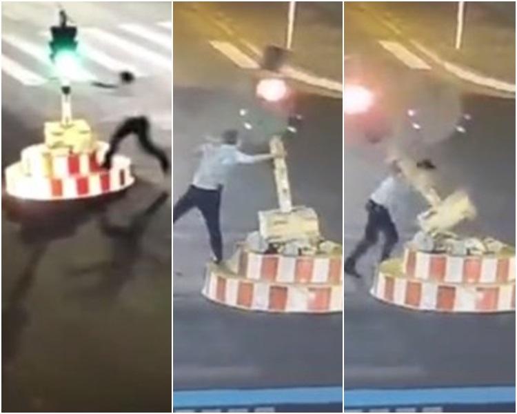 開車男等2分鐘轉燈都嫌太耐下車衝過去扯跌紅綠燈。網圖