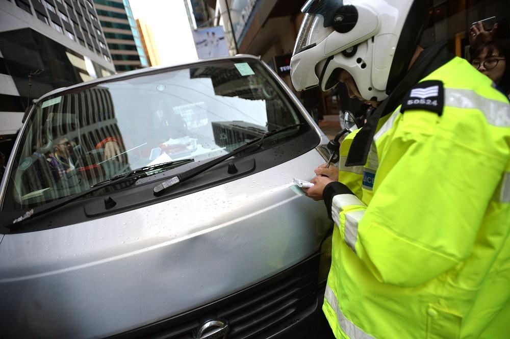 行動中,警方共發出2059張定額罰款告票和110張傳票。 資料圖片