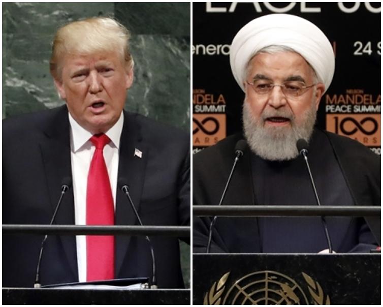 魯哈尼(右)表示,伊朗不想與美國打仗。AP