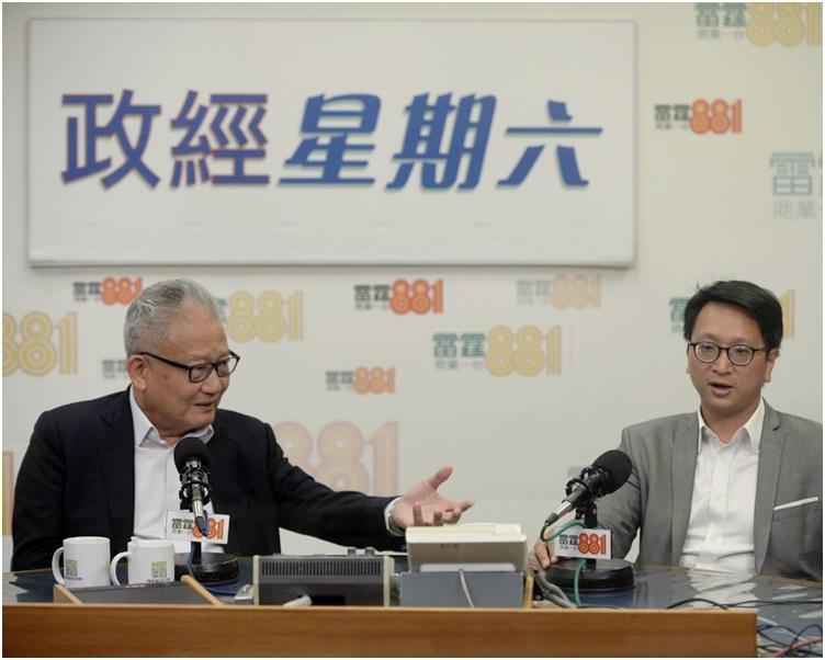 鄧家彪認為最低工資每小時應增至42.5元才合理。左為吳宏斌。
