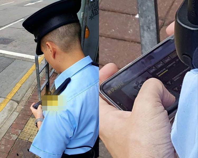 一名軍裝警員在當值時機,疑用手機玩電子遊戲。巴打絲打 Facebook Club fb圖片