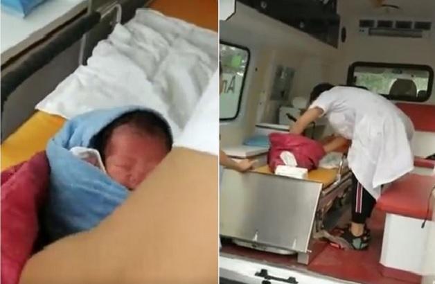 警員將被掛在崖邊樹杈上的女嬰救起,由救護車送院治理。