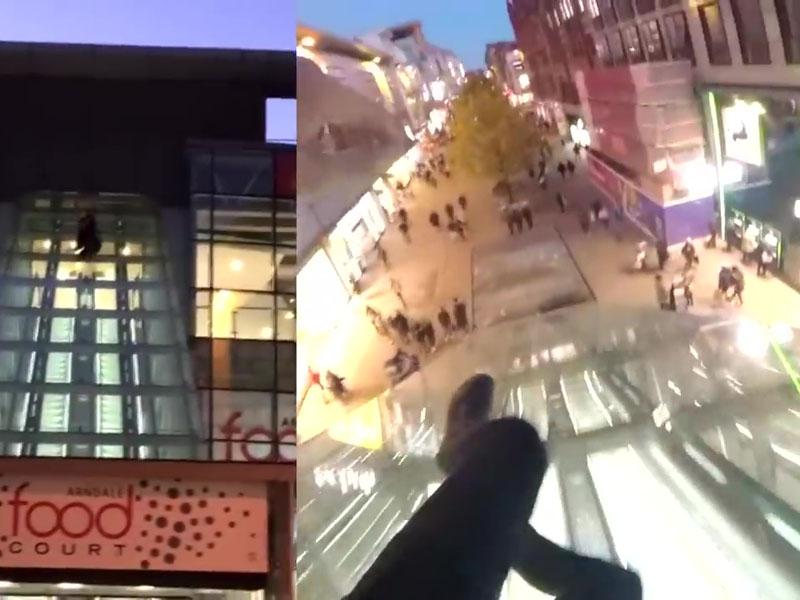 英國一名男子從距離地面約15米高的玻璃外牆頂處滑落地面,並拍攝片段分享,惹來網民狂轟。(網圖)