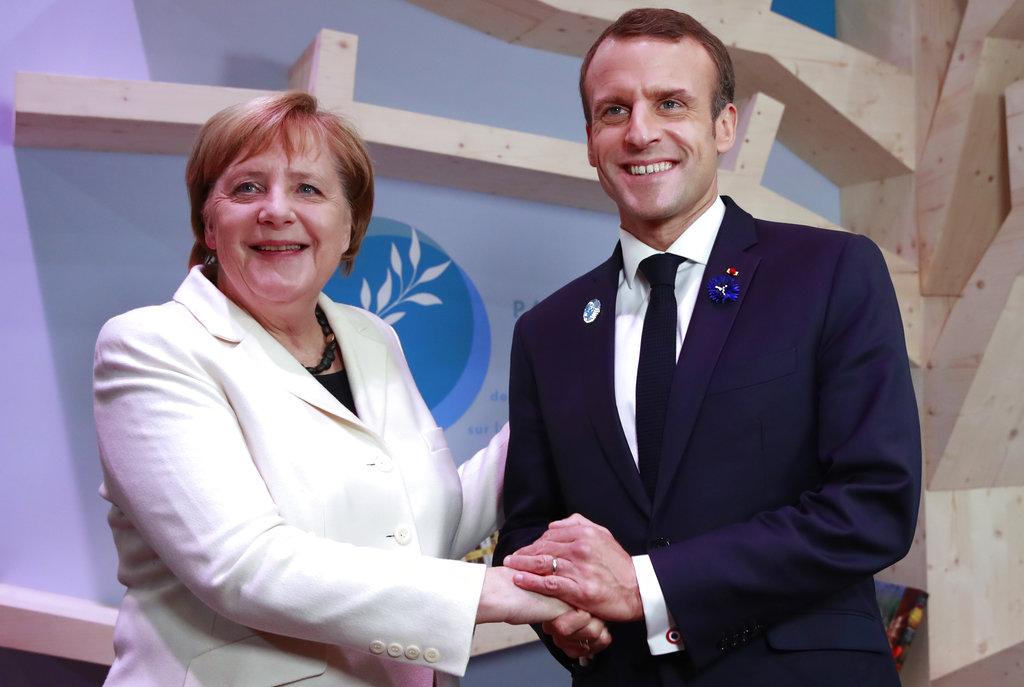 默克尔和马克龙都呼吁採取一致行动,促进世界和平。