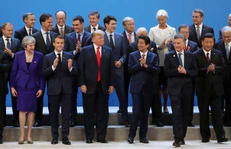美國總統特朗普(前左三)與中國國家主席習近平(前右一)。AP
