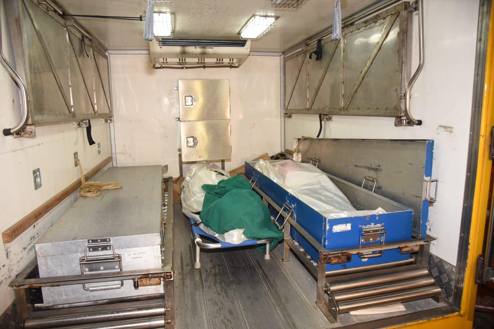死者屍體移送殮房。