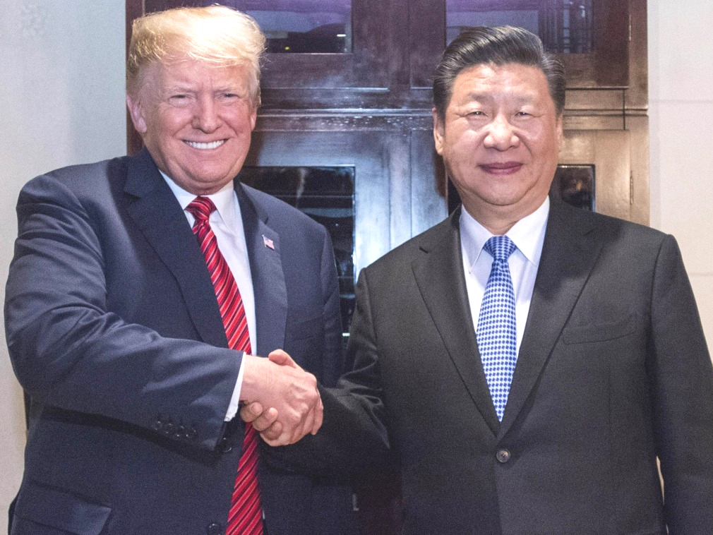 習近平與特朗普達成貿易戰暫時停火的共識。新華社