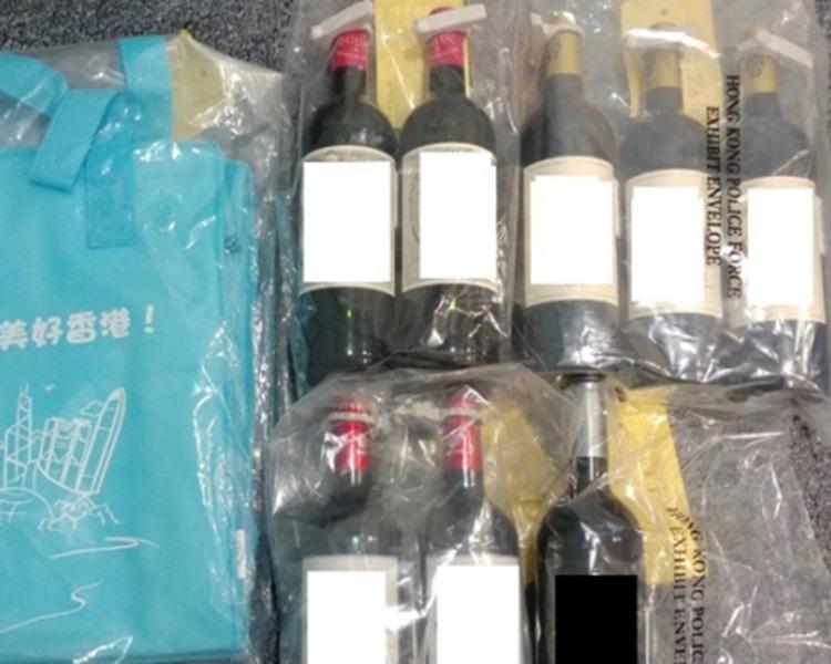 超市偷酒四人幫斷正被捕。警方圖片