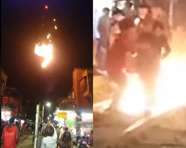 當著火的天燈墮地,女途人的衣服被火花燒着,幸得店家上前拍掉火花。影片截圖