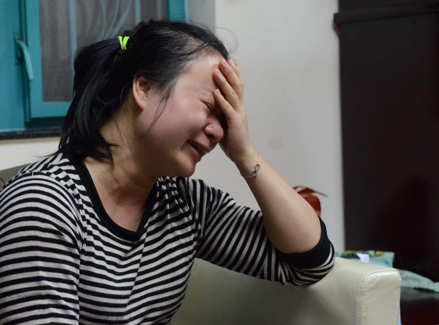 遺孀哭得聲嘶力竭,擔心日後如何養育三個兒子。