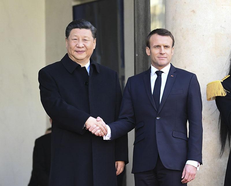 中國國家主席習近平周一抵達巴黎,繼續對法國國事訪問。(新華社)