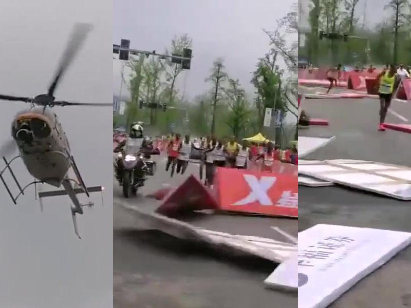 重慶馬拉松一架直升機因飛得太低,吹散了分隔板,令一名選手受傷。(網圖)