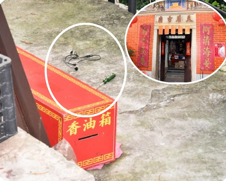 香油箱懷疑被賊人搬至山坡旁。現場遺下一支螺絲批和耳機(中)。