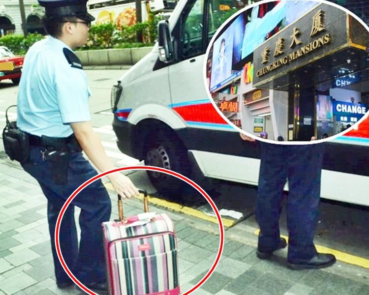 警方事後帶走女子隨身行李喼返回警署(紅圈示)。