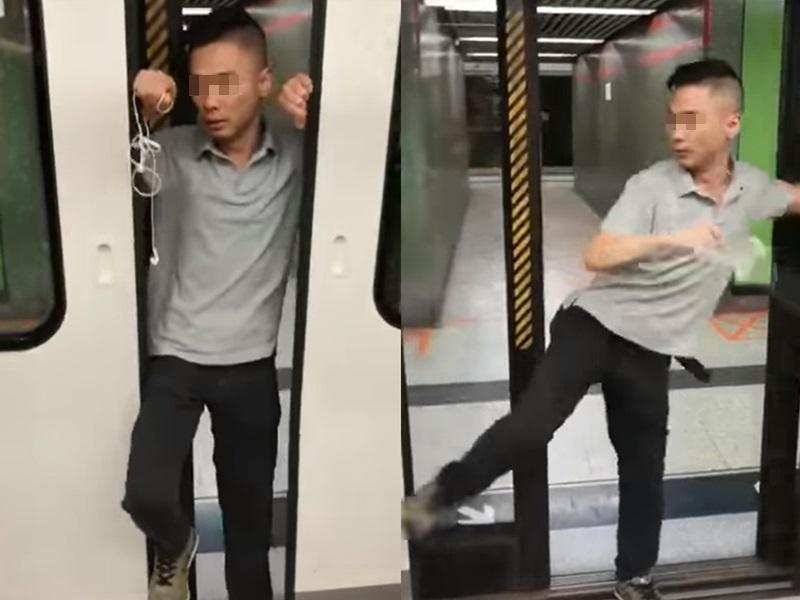 一名怀疑神志不清的男子,用身体档着又脚踢港铁列车车门。FB截图