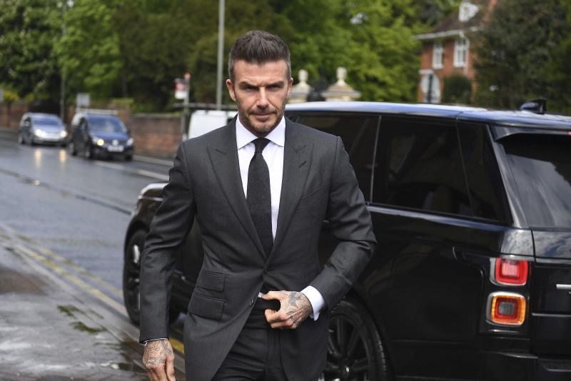 英格兰前球星碧咸因驾车时使用手机被罚停牌半年。AP