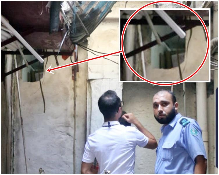 懷疑被賊人被鑿穿的牆身(紅圈示)。