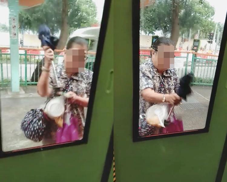 大媽因為趕不上車,竟然以雨傘作為武器,敲打車門玻璃。網民Yu Mui影片截圖
