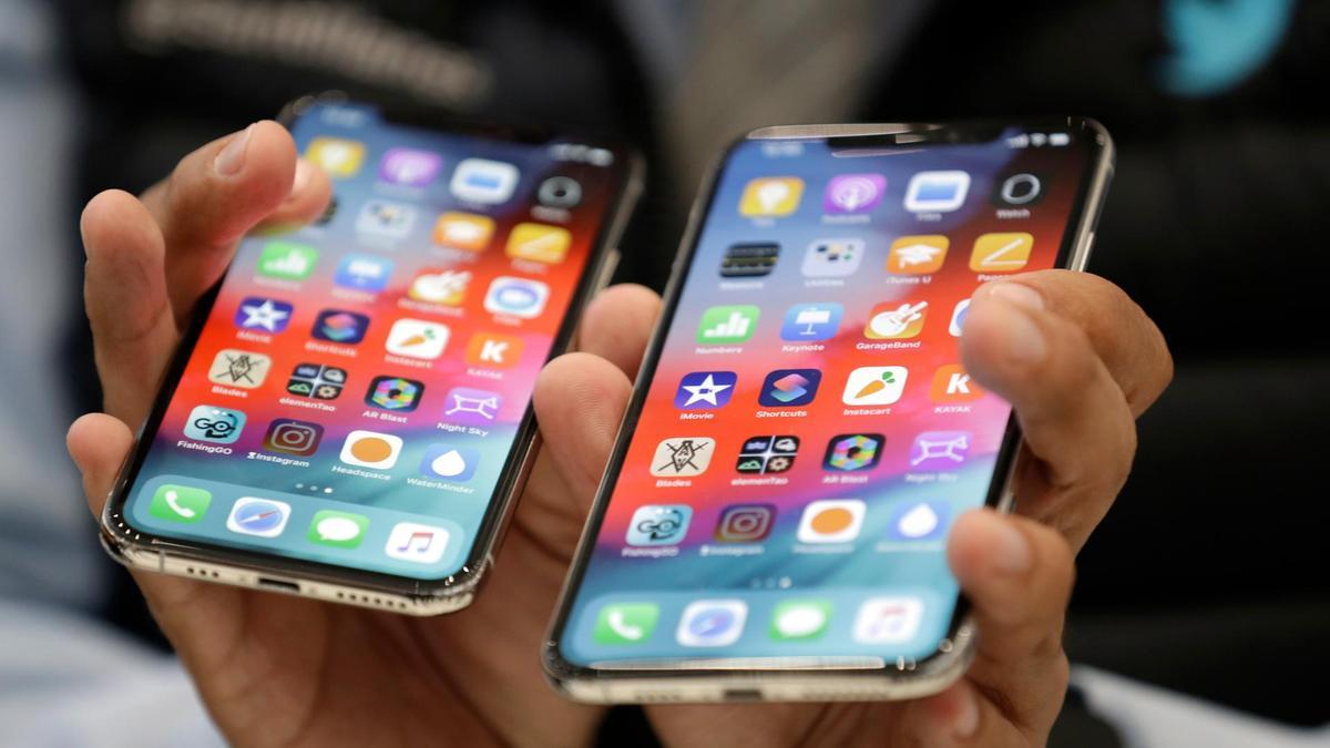 中国男子在美国利用保养诈骗1500部苹果手机。图片