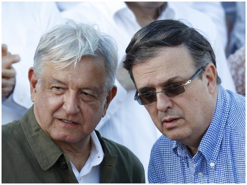 洛佩斯(左)与外长埃布拉德。